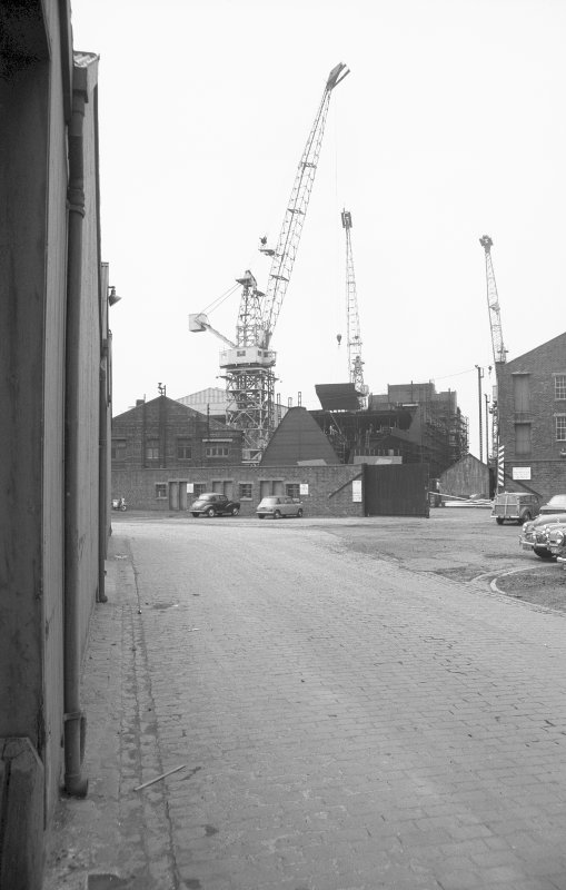 View from SE (possible) showing works buildings and cranes