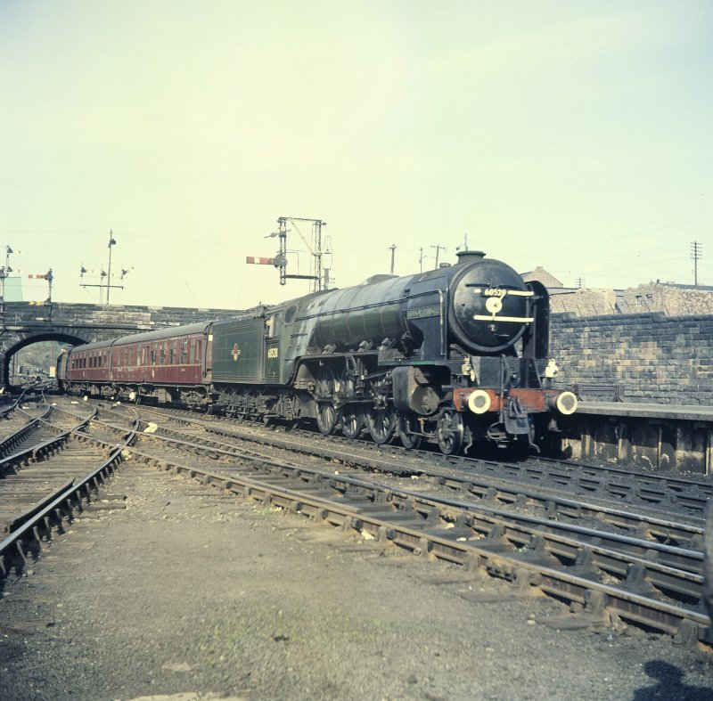 View from SW (possible) showing Aberdeen - Glasgow train arriving at station