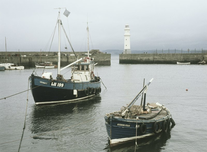 View from ESE showing fishing boats in harbour and lighthouse, Newhaven, Edinburgh
