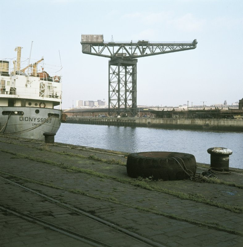 View from SSE showing crane with part of 'Dionyssos II' in foreground