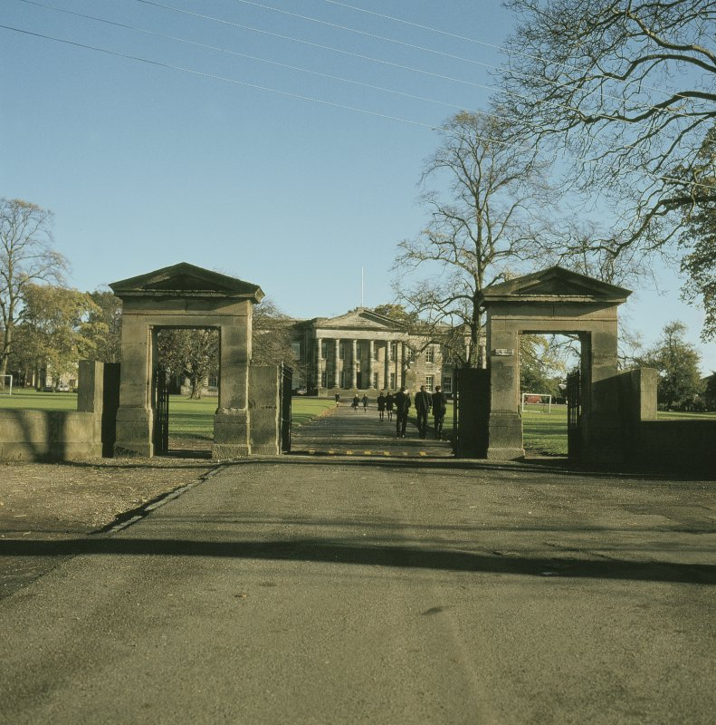 View from WSW showing WSW front of main building through gates