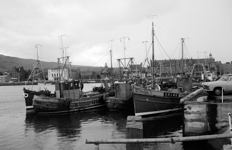 View from NE showing fishing boats moored on old quay