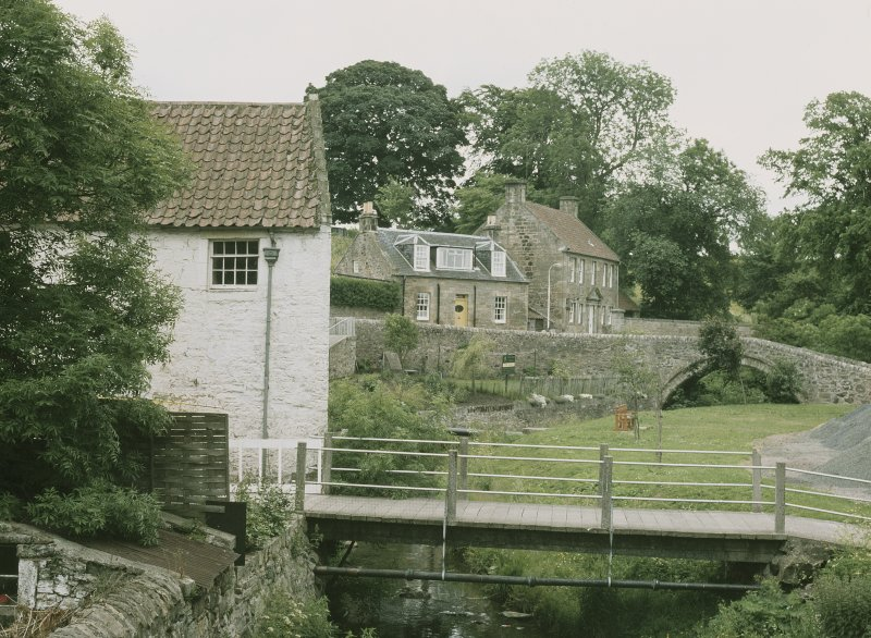 General view from NNW showing bridge, cottage and Masons Lodge in background