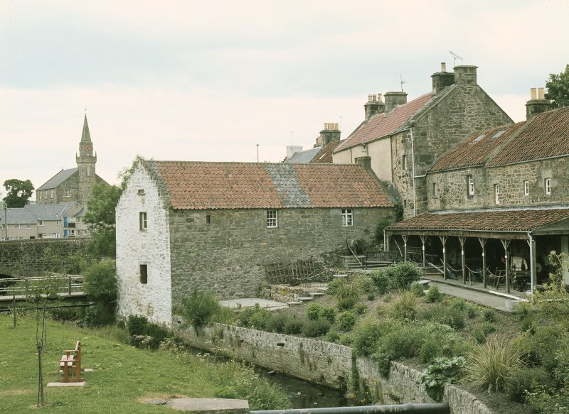 View from S showing WSW and SSE fronts at rear of museum with church in background