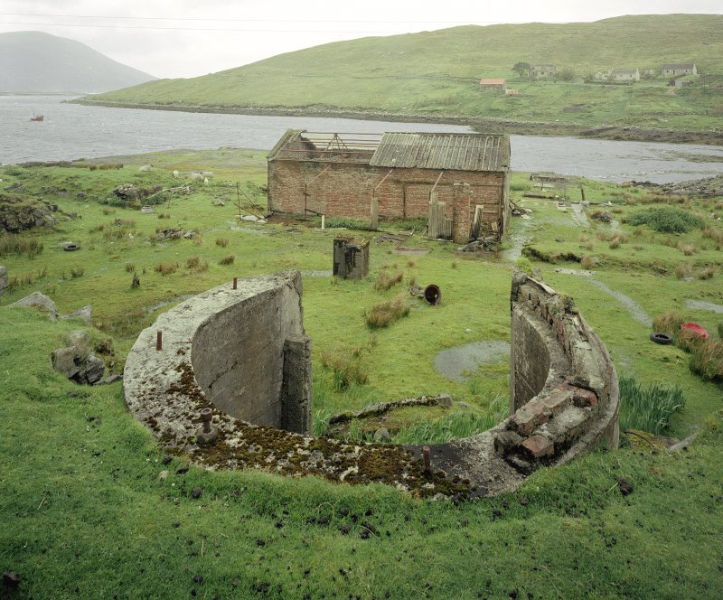 View from E of part-circular concrete base for boiler (foreground), and byre built from brick salvaged from demolished chimney Digital image of C 68887 CN