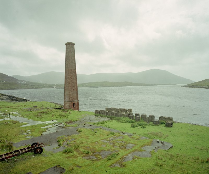 View from NNE of surviving boiler-house chimney.  To left of chimney was milling area, the boiler house being situated in the foreground.  The concrete structures to the right were bases for whale oil tanks Digital image of C 68895 CN