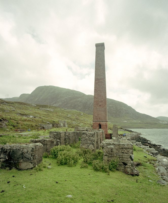 View from NNW of suviving boiler-house chimney, with concrete bases of former whale-oil tanks in foreground Digital image of C 68897 CN