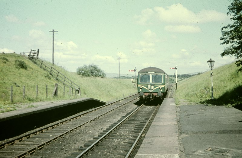 View from WSW showing train from Lanark approaching station