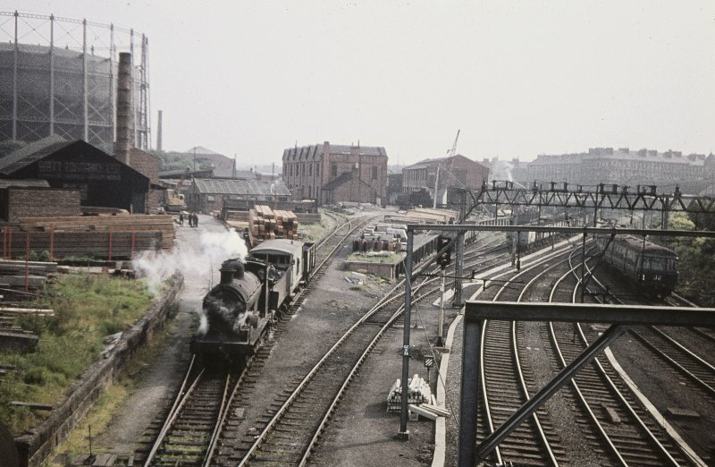 General view from WSW showing goods train in works with works blocks in central background