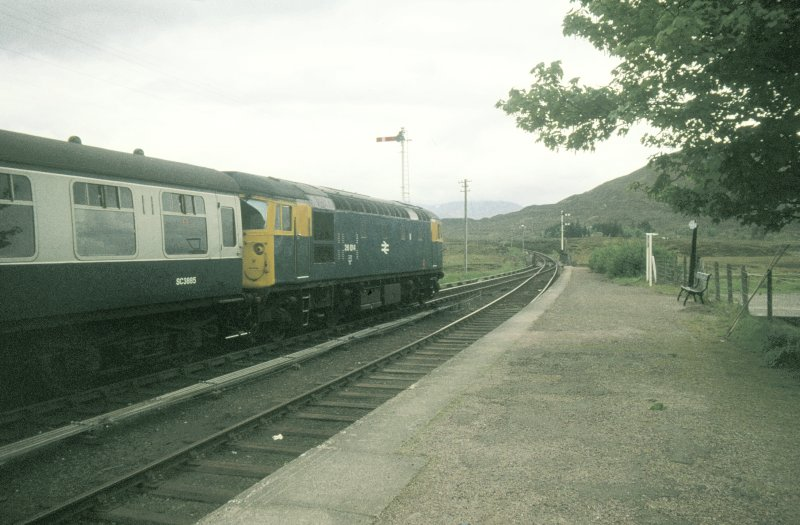 View from NE showing Inverness - Kyle of Lochalsh train in station