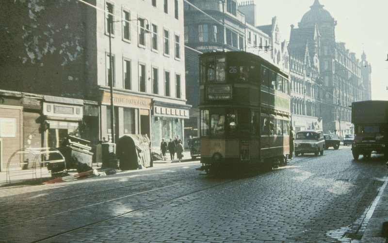 View from W showing tram no 26 on Trongate with steeple in distance