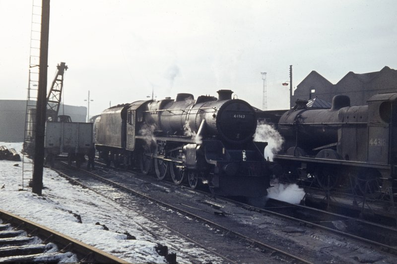 View from NE showing locomotives with part of engine shed in background