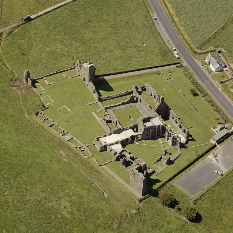 Oblique aerial view centred on Crossraguel Abbey.