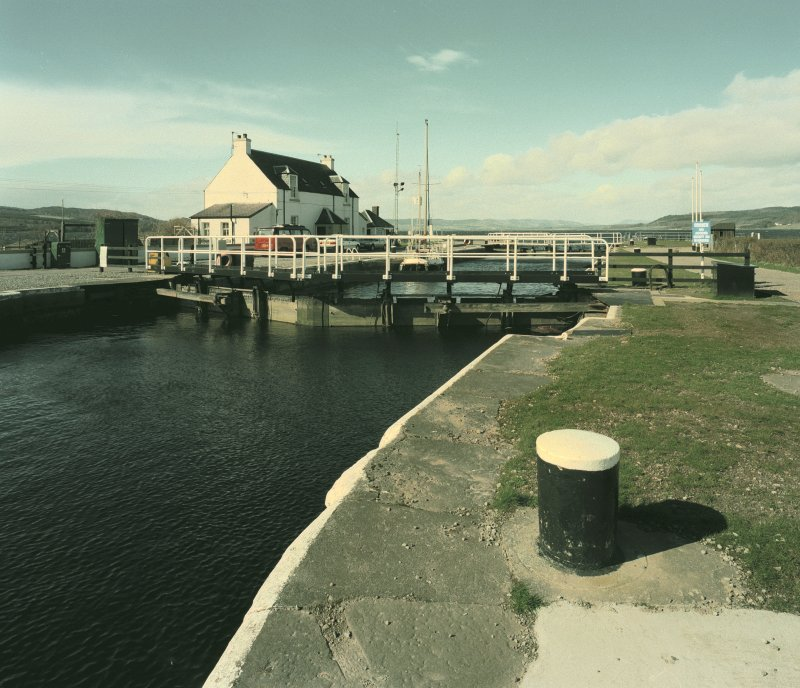 Inverness, Clachnaharry, Caledonian Canal, Clachnaharry Sea Lock View from the east showing the top lock gates of the Sea Lock.  The lock keepers' houses are visible beyond Digital image of D 64144 CN