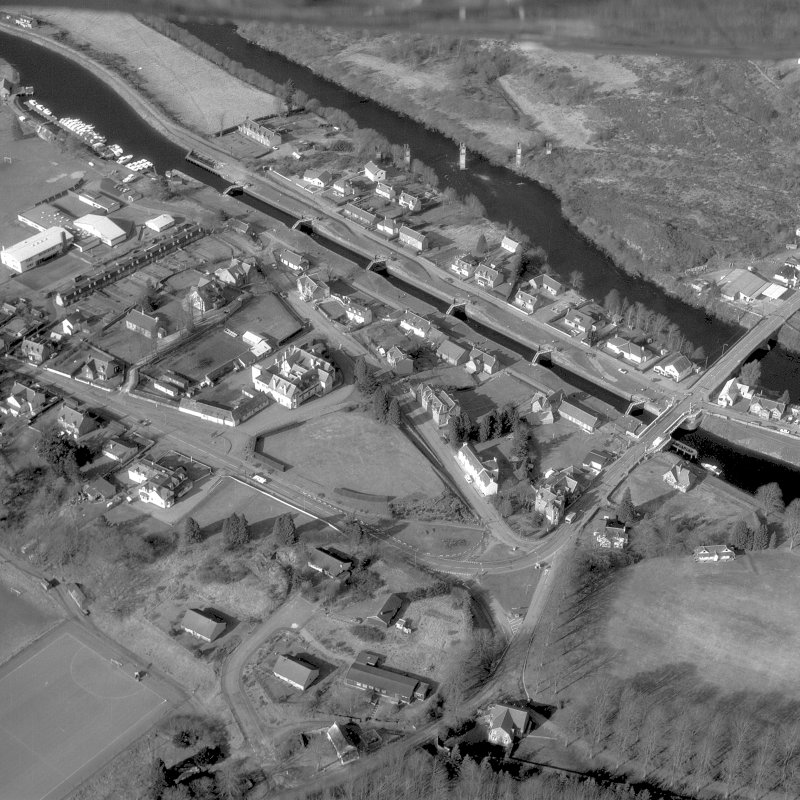 Scanned image of photograph showing oblique aerial view of Fort Augustus Locks and village.