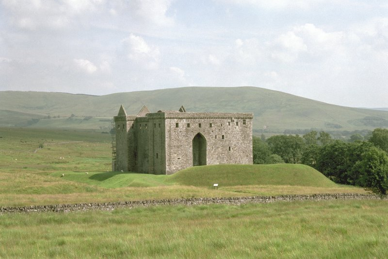 View of Hermitage Castle from north-west, showing the earthwork in the foreground which survives from the 13th century predecessor to the 14th to 16th century stone castle. Digital image of C 67763 CN