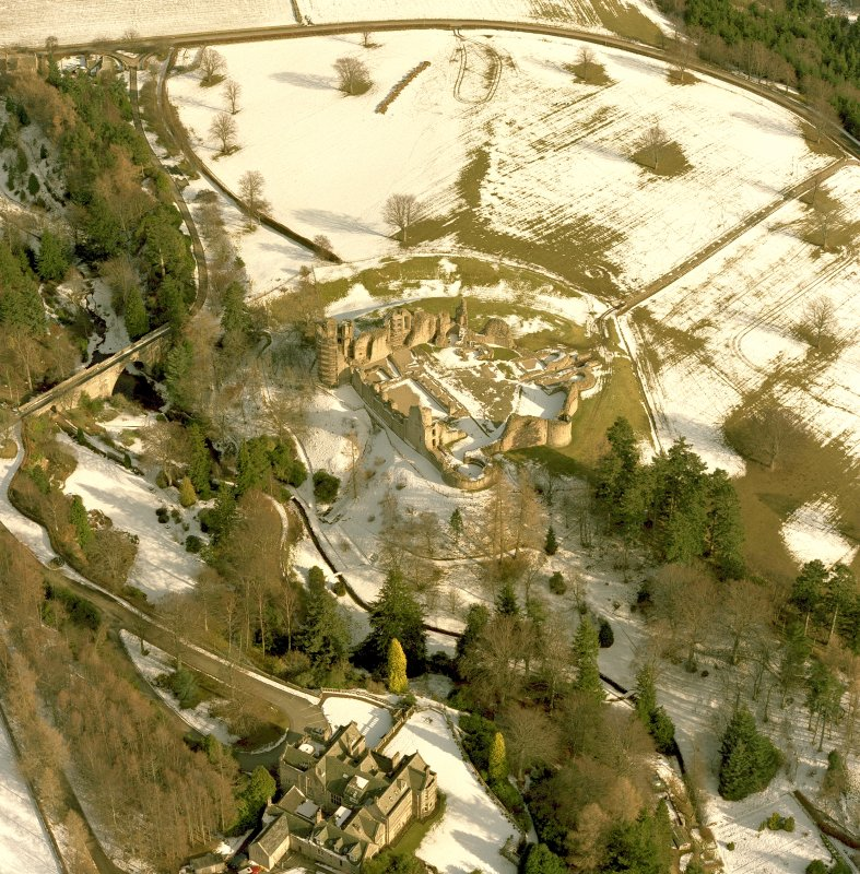 Oblique aerial photograph, taken from the W, centred on Kildrummy Castle. Digital image of B 79985 CN