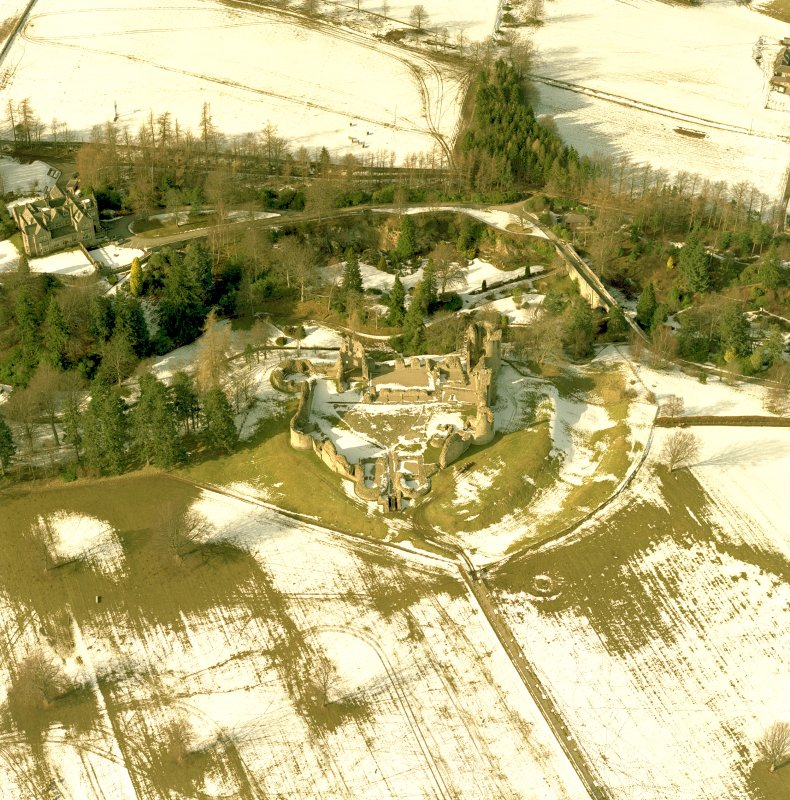 Oblique aerial view centred on Kildrummy Castle in the snow , taken from the South South-East.