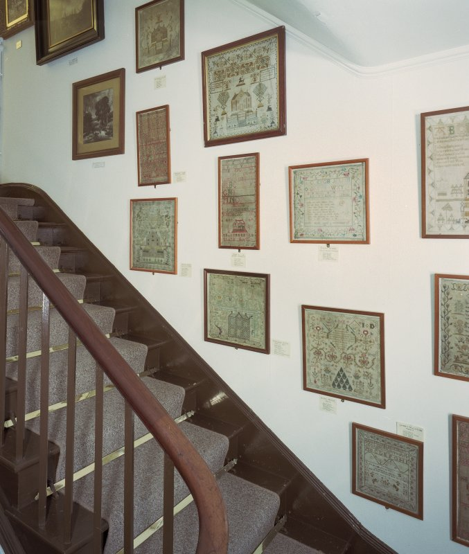 Interior, view of staircase with display of samplers Digital image of E 30915 CN