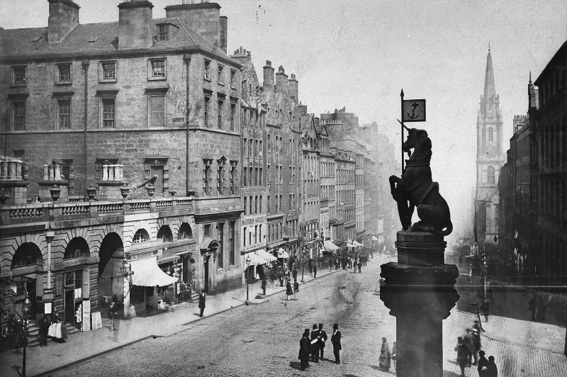 The unicorn atop the Mercat Cross with view from SW of High Street and City Chambers, Edinburgh. 1869 Photo montage.