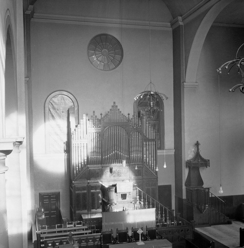 Interior view of Canongate Church, showing wall and organ across the apse.