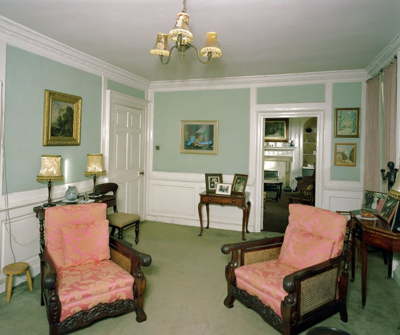 Interior, view of first floor drawing room from West showing paneled walls and view to sitting room