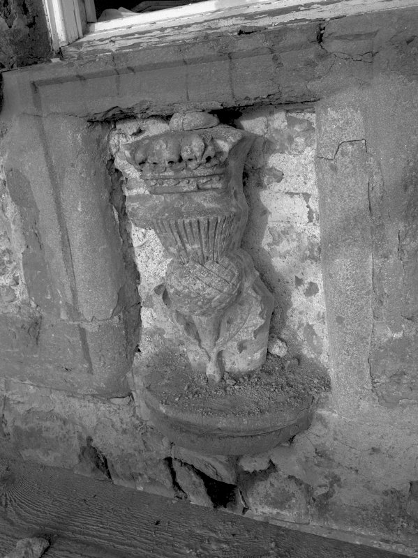 Fyvie Castle. View of carved panel above central arch of Seton Tower South elevation during restoration. Digital image of B 10738.