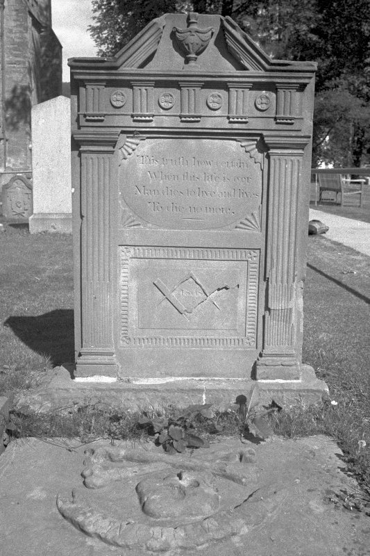 Dunkeld, Dunkeld Cathedral, Burial Ground. View of gravestone of Catherine Menzies and Agnes Ballantine, dated 1811. Neo-classical fluted pilasters with broken pediment and urn. Mason's tools at base. Gravestone inscribed with: 'This truth how certain/ When this life is o'er/ Man dies to live and lives/ To die no more.' Digital image of A 34453