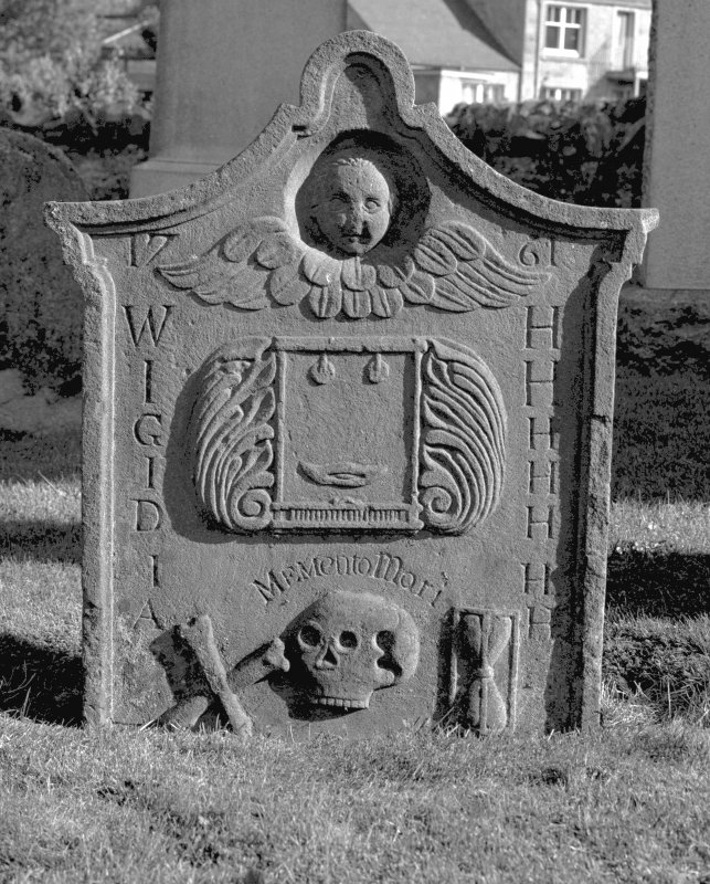 General view of West face of the tombstone commemorating Alexander Henderson's parents. A winged soul above weaving loom and shuttle with foliate surround, crossed bones, skull and hourglass. Insc: '1761. WH, IH, GH, IH, DH, IH, AH. Memento Mori'. St. Serf's Parish Church & Graveyard, Dunning. Digital image of PT 4314