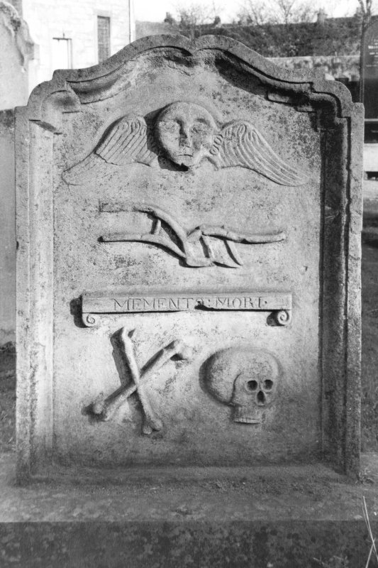 Dunning, St. Serf's Parish Church. General view of the gravestone of William Frazer, 1756. Winged soul, plough, 'Memento Mori' ribbon, crossed bones and skull. Scanned image of A 37031 PO