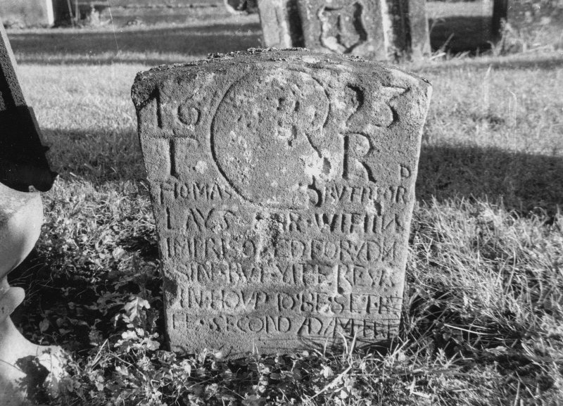 Dunning, St. Serf's Parish Church, Graveyard. General view of headstone to Thomas Rutherford, 1623. Incised skull/head. Scanned image of A 37032 PO