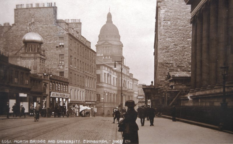 View of Nicholson Street showing frontages of Empire Palace and Old College of Edinburgh University