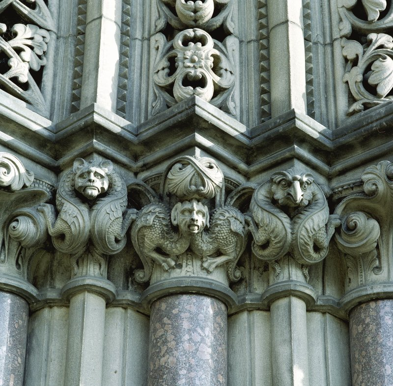 Detail showing gargoyles on colonette capitals to right hand side of main entrance in SW elevation.