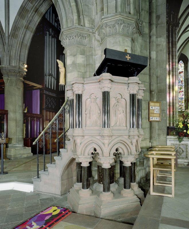 Interior. View of pulpit near NW angle of nave.