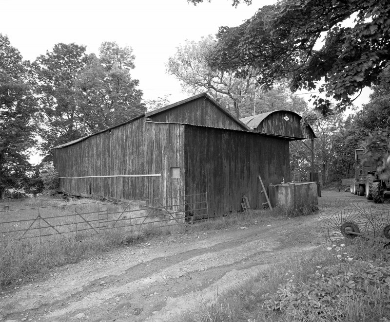 View of hay barn from East.