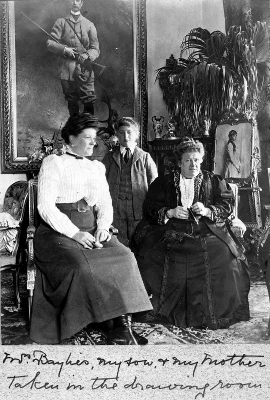 View of family group in the drawing room at Balmacaan House.  Titled: 'Mrs Baylies, my son & my mother. Taken in the drawing room'. PHOTOGRAPH ALBUM No.32: BALMACAAN ALBUM.
