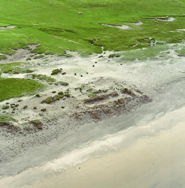 Oblique aerial view centred on the remains of the Viking settlement, taken from the E.