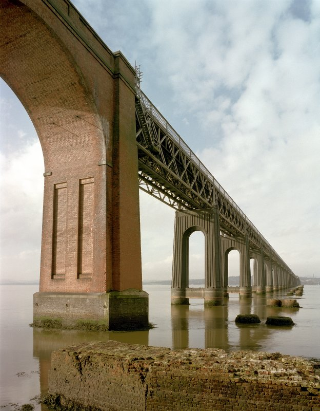 Digital image of view from SSE of south end of bridge, with foundation of old bridge pier in foreground
