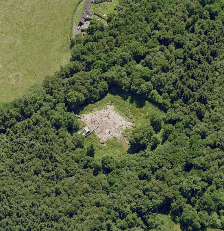 Oblique aerial view centred on the excavation of the old castle, taken from the NW.