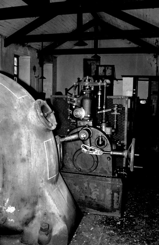 Interior. View of Hydro-electric power station, Dunecht Estate, Garlogie, Aberdeenshire, installed by Viscount Cowdray in the early 20th century. This view shows part of the Brown Boveri turbine, with the speed governor in the background. Copy of 35 mm black and white negative.