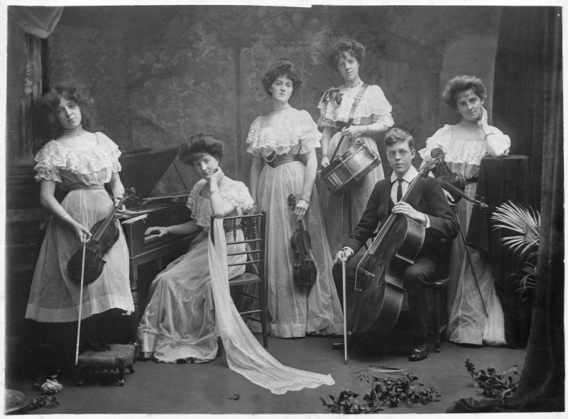 View of members of the Mather family with instruments, 16 Leamington Terrace, Edinburgh.