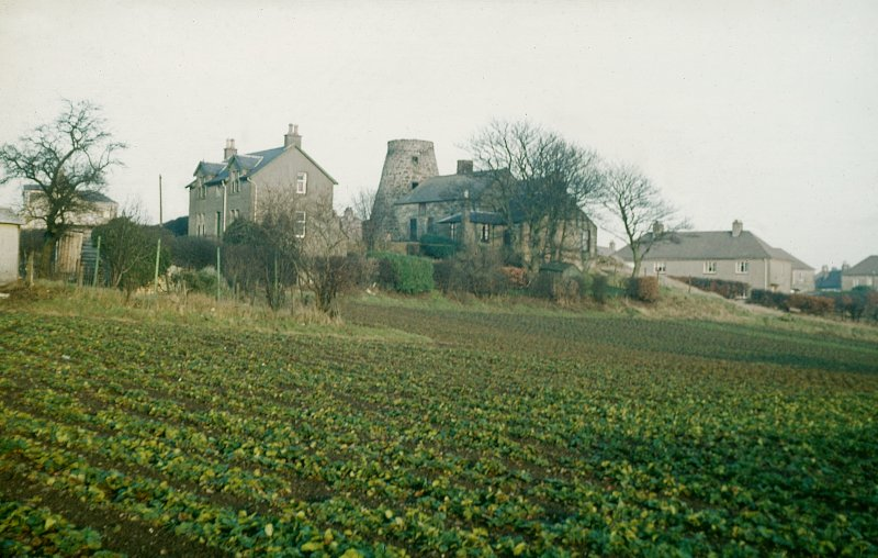 General view from WSW showing SSW and WNW fronts of miller's house and mill block. Copy of 35 mm colour transparency.