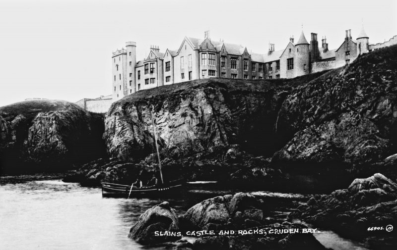 Digital image of photographic copy of postcard view from cliffs. Insc: 'Slains Castle and Rocks Cruden Bay'.