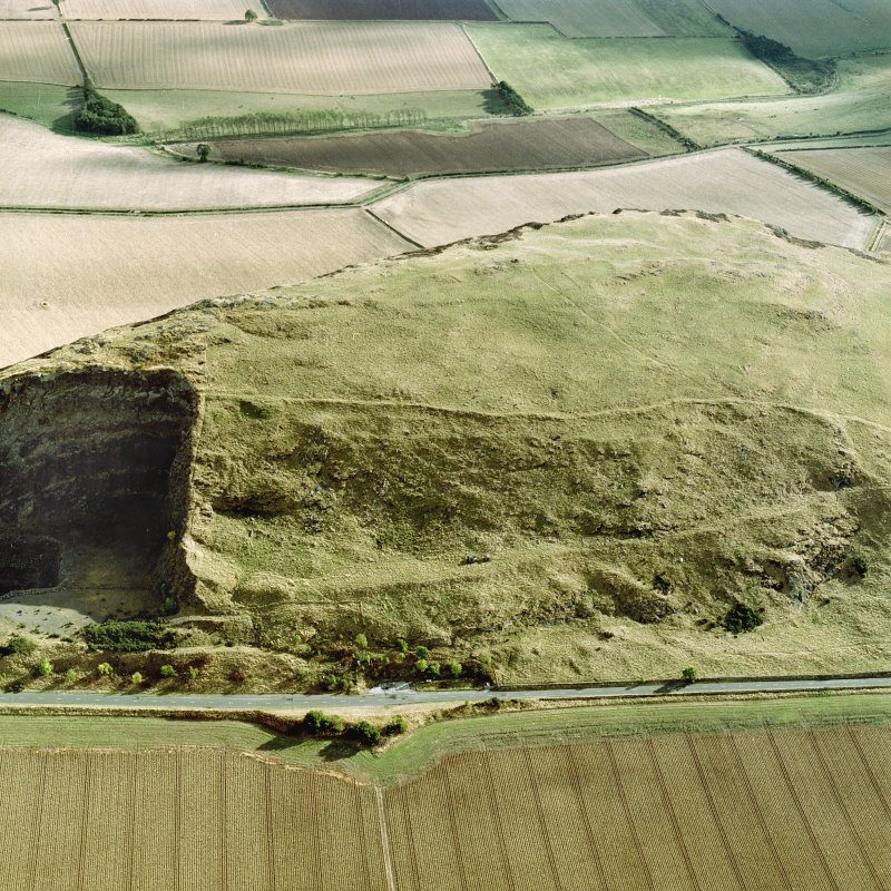 Oblique aerial view centred on the remains of the fort showing recent fire damage, taken from the N.