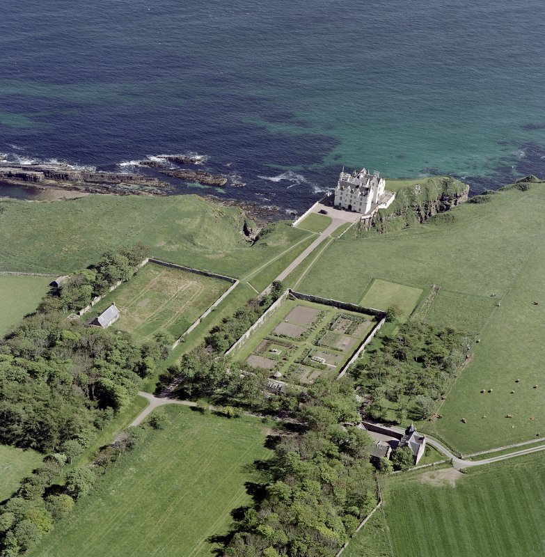 Oblique aerial view of Dunbeath Castle and walled gardens from SW.