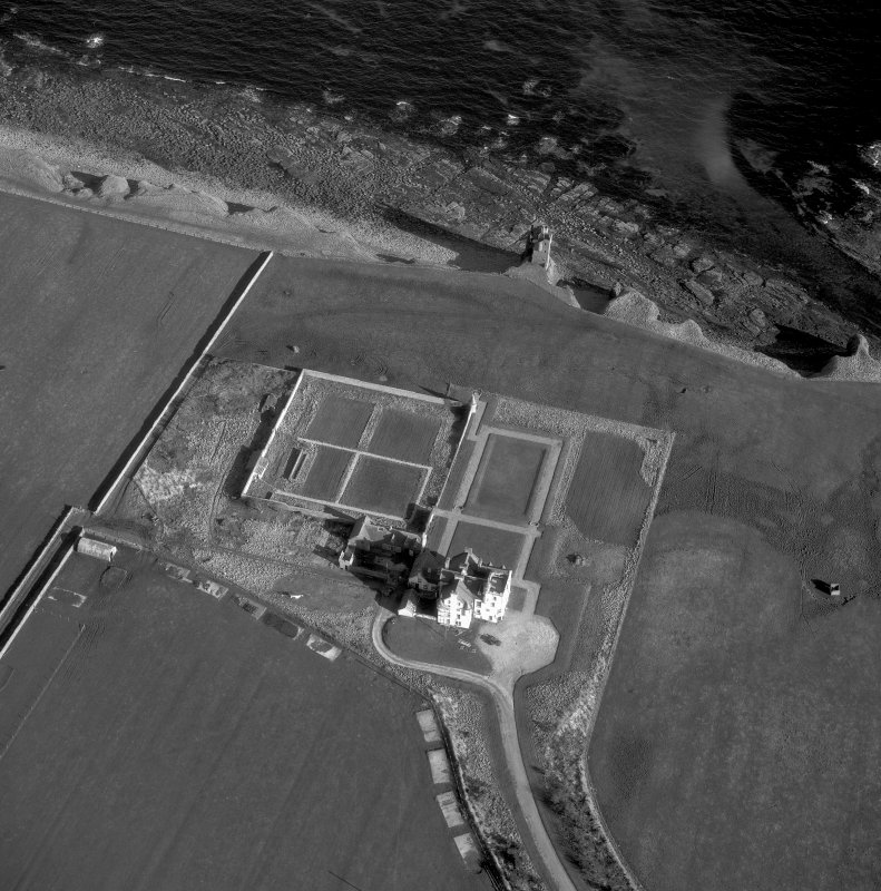 Oblique aerial photograph showing old and new castles and nissen huts.