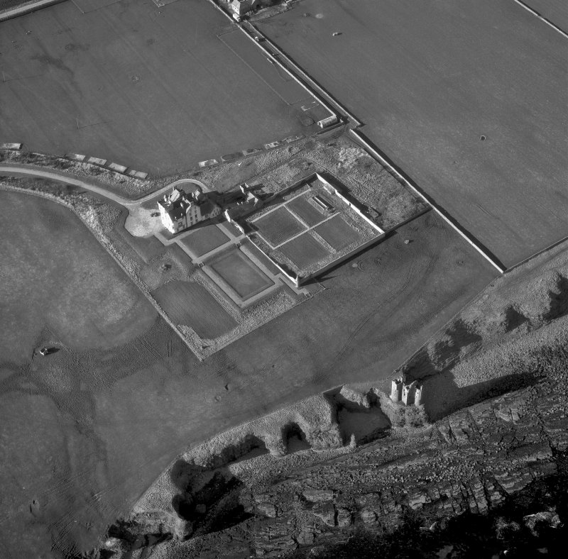 Oblique aerial photograph showing old and new castles, and nissen huts