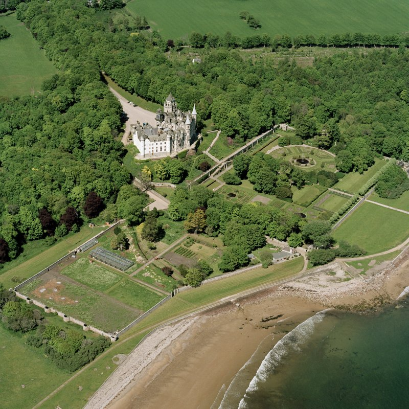 Oblique aerial view of Dunrobin Castle, walled garden and formal gardens, taken from the SW.