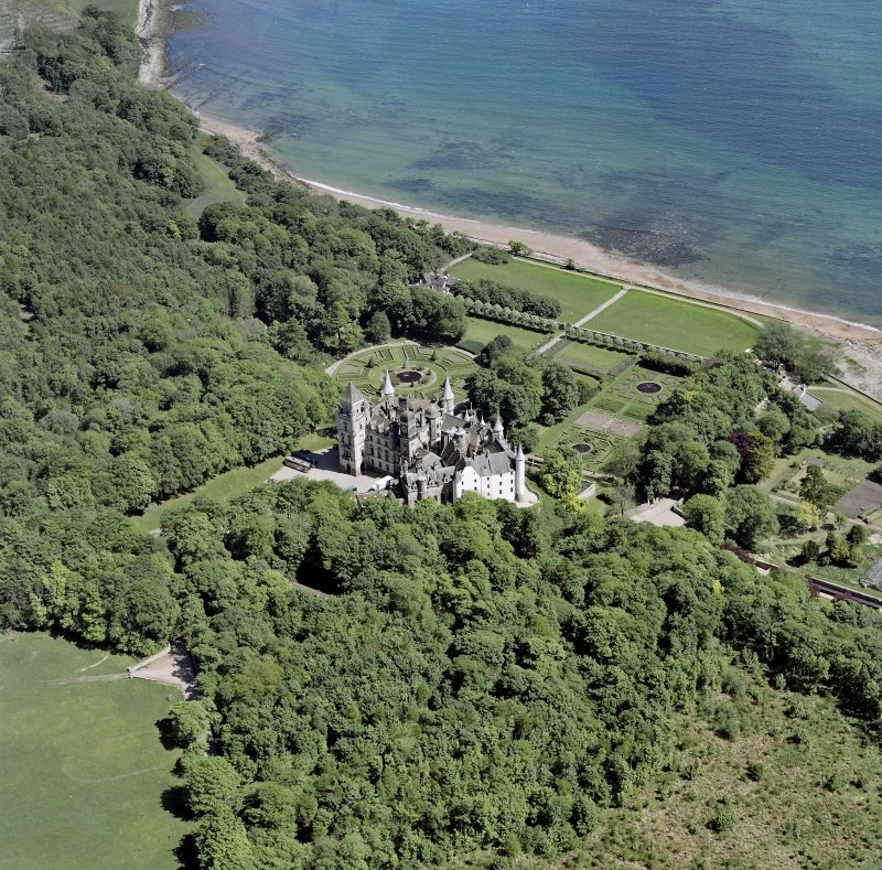 Oblique aerial view of Dunrobin Castle, walled garden and formal gardens, taken from the NW.