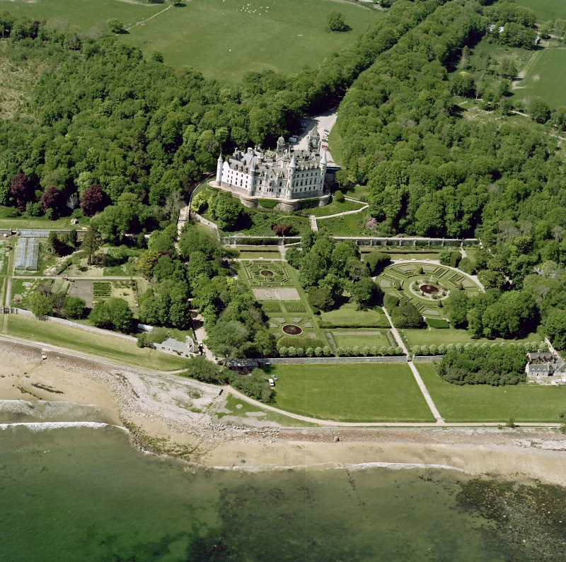 Oblique aerial view of Dunrobin Castle, walled garden and formal gardens, taken from the E.